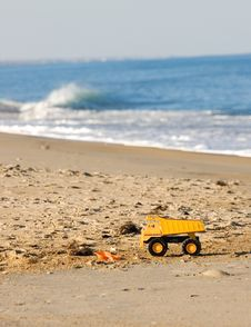 Free Yellow Toy Truck On Beach Stock Photo - 3789840