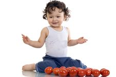 Free Child With Tomato. Royalty Free Stock Photography - 3792017