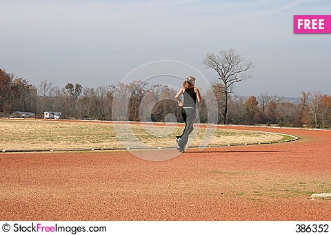Free Athletic Young Woman Running At The Track Stock Photography - 386352