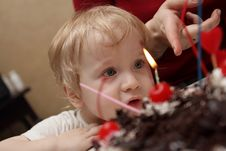 Free Boy Looks At Candles Royalty Free Stock Image - 3807566