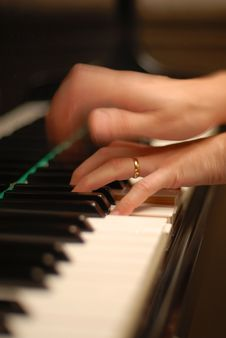 Hands Playing The Piano Royalty Free Stock Photos
