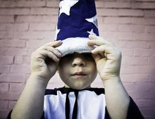 Free Boy Looking Out From A Wizard Hat Royalty Free Stock Images - 3814489