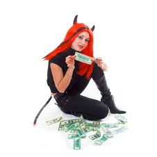 Red Devil Girl Showing Cash Royalty Free Stock Photography