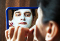 Free Young Woman Takes Beauty Mask In Front Of Mirror Stock Photography - 38185222