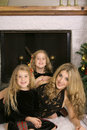 Free Mother With Twin Daughters By Fireplace Vertical Royalty Free Stock Image - 3827176