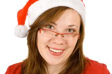 Young Smiling Girl With Santa Hat And Specs Stock Photos