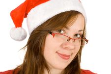 Young Smiling Girl With Santa Hat And Red Specs Stock Photos
