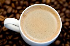 Free Coffee Cup With Beans Under The Cup Royalty Free Stock Photo - 3822995