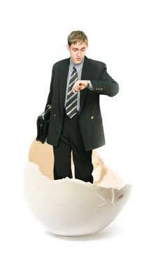 Young Businessman And Big Egg Royalty Free Stock Image