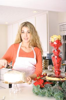 Free Woman In The Kitchen Frosting A Cake Royalty Free Stock Photo - 3826745