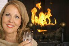 Free Stunning Woman In Front Of Fireplace Royalty Free Stock Images - 3827029