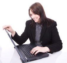 Free Young Woman Looks At Her Laptop Royalty Free Stock Image - 3827056