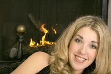 Free Happy Blonde By The Fire Stock Photography - 3827142