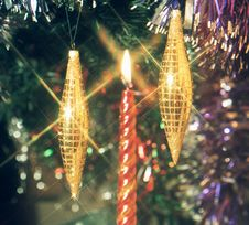 Free Candle And Gold Icicles Stock Image - 3828081