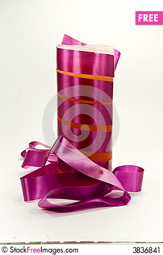 Free A Purple Candle With Ribbon Stock Image - 3836841