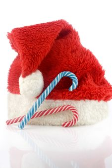 Free Candy Cane And Red Cap Royalty Free Stock Photos - 3830128