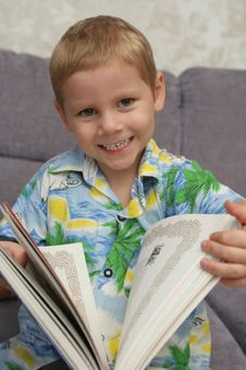 The Happy Boy Holds The Greater Book In Hands Royalty Free Stock Photos