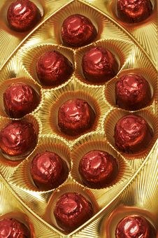 Free Chocolates In A Red Foil Stock Photos - 3834593
