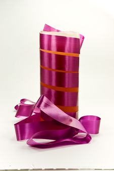 A Purple Candle With Ribbon Stock Image