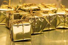 Free Stack Of Golden Gift Boxes Stock Images - 3838134