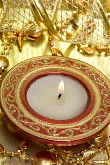 Red Candle On Golden Stock Image