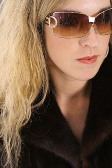 Beautiful Blonde In Mink Fur And Glasses Stock Photography