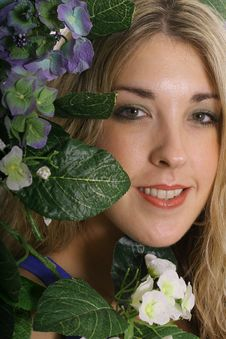 Free Gorgeous Woman Headshot In Flowers Upclose Stock Photography - 3842292