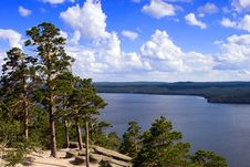 Free Pines And Blue Lake Stock Photo - 3849790
