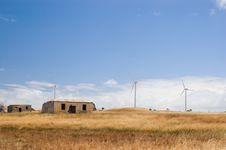 Forgotten Farmhouse And New Wind Turbines Stock Image