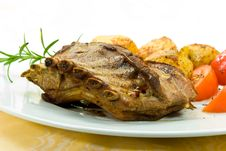 A Roasted Suckling Pig With Potatoes And Salad Stock Photography