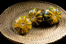 Free Three Striped Pumpkins On Wickerwork Plate Stock Photo - 3855910