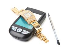 Smartphone And Gold Watch. Stock Photos