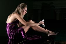Free The  Girl Puts A Cream On Legs Stock Photography - 3861512