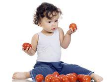 Free Child With Tomato. Stock Photo - 3863330