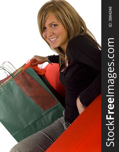 Woman with shopping bags on red couch