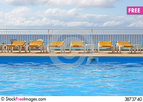 Free Pool Sunbeds Around A Pool Stock Photo - 3873740