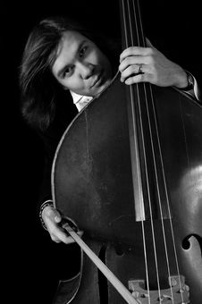 Free Melancholy Musician With A Contrabass Royalty Free Stock Image - 3871566