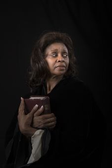 Free Woman With Bible Looking Left Stock Images - 3871694