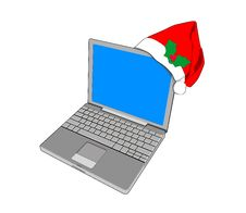 Laptop Computer With Santa Hat Stock Image