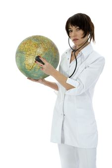 Young Doctor With Stethoscope And Globe Stock Photography