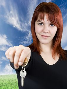 Free Redhead Girl Passing Keys Stock Image - 3875561