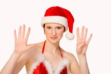 Studio Portrait Of A Christmas Faerie Counting 9 Stock Photo