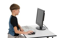 Free Boy On His Computer Royalty Free Stock Image - 3878076