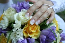 The Gentle Hand Of The Bride Lays On A Bouquet Stock Photography