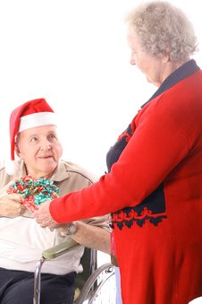 Elderly Man In Wheelchair Giving Wife A Present Stock Images