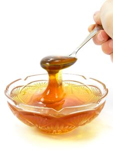 Honey In A Crystal Saucer Stock Photography