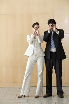 Free Businesswoman And Man Peering Through Tubes Stock Images - 3883714