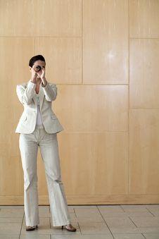 Businesswoman Peering Through Tube Stock Image