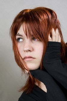 Free Cute Redhead With Messy Hair Looking Away Royalty Free Stock Photography - 3886247