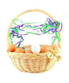 Easter Basket With A Bow, Eggs And Garland Stock Photo